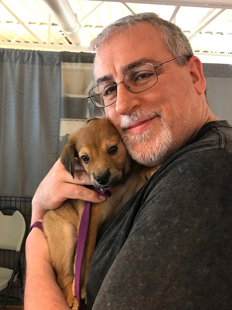 Brian Garrison holding a puppy