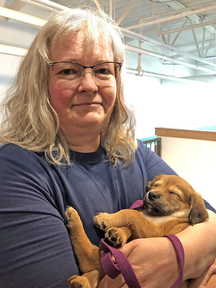 Jen Garrison holding a puppy